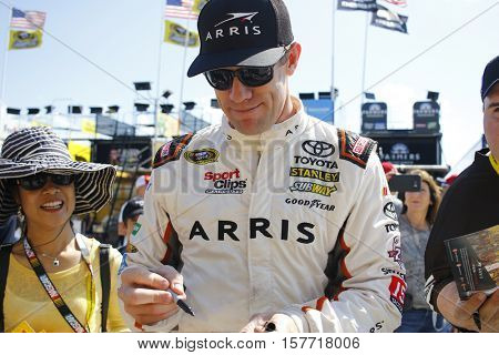 Homestead, FL - Nov 18, 2016: Carl Edwards (19) signs autographs on the way to practice for the FORD EcoBoost 400 at the Homestead-Miami Speedway in Homestead, FL.