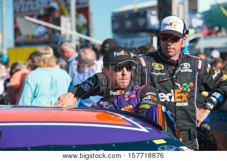 Homestead, FL - Nov 20, 2016: Denny Hamlin, driver of the #11 FedEx Express Toyota, gets ready for action  during the Ford EcoBoost 400 weekend at the Homestead-Miami Speedway in Homestead, FL.