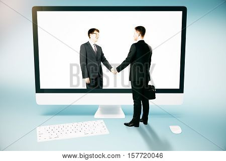 Businessperson shaking hands with abstract digital partner through huge computer screen. Online business and partnership concept. 3D Rendering