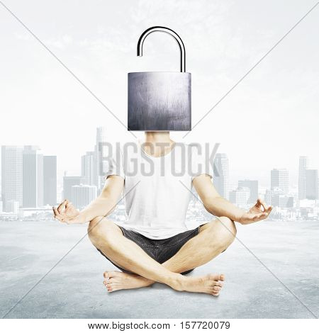 Meditating man with open iron lock instead of head on city background. Unlocking mind to find new solutions