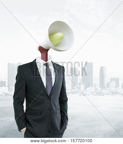 Loud speaker headed businessman on city background. Communication voice and power concept