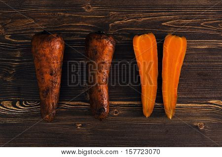Boiled carrots on a dark wooden background