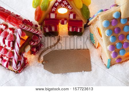 Label With Copy Space For Advertisement. Colorful Gingerbread House On Snow. Christmas Card For Seasons Greetings