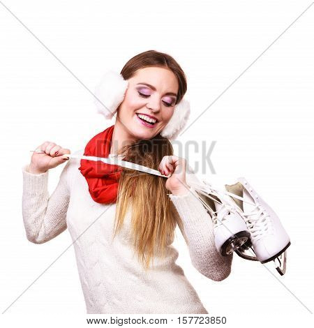 Woman Wearing Ear Muffs Holding Ice Skate