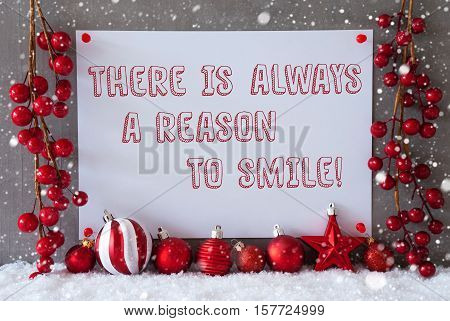 Label With English Quote There Is Always A Reason To Smile. Red Christmas Decoration Like Balls On Snow. Urban And Modern Cement Wall As Background With Snowflakes.