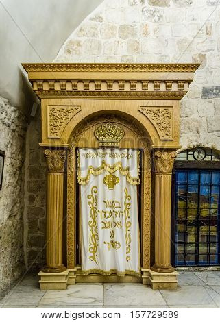 JERUSALEM ISRAEL - OCTOBER 5: The Holy Ark with curtain covering containing the Holy Torah old testament scrolls in the tomb of King David Jerusalem Israel on October 5 2016