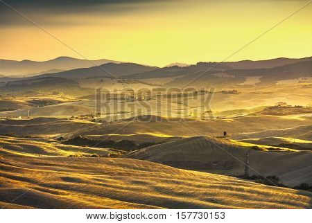 Volterra panorama rolling hills and green fields on sunset. Rural landscape. Volterra Italy Europe
