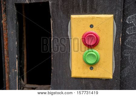 Yellow panel with rempty red and green buttons