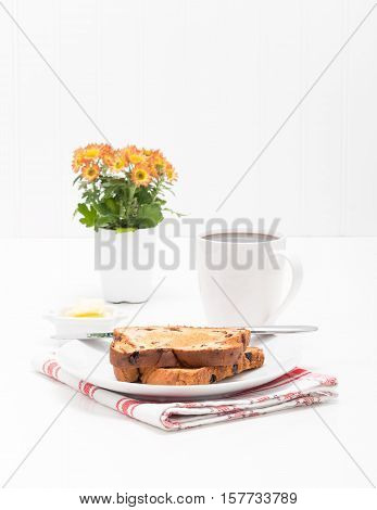 Slices of cinnamon raisin toast served with fresh brewed coffee.