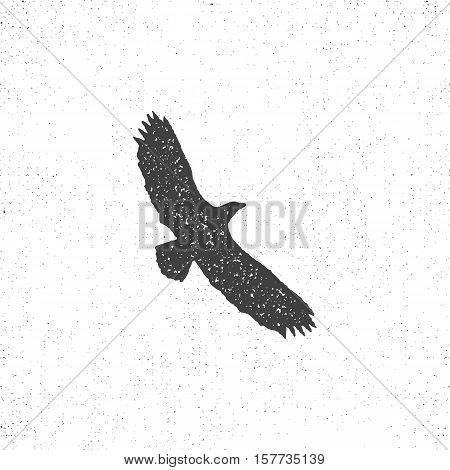 Eagle silhouette symbol. Retro style. Letterpress effect. Eagle icon design. Vector vintage element.