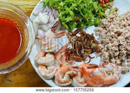 spicy prawn and wing bean salad with tamarind sauce prepare to cook on dish