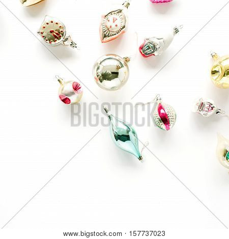 creative arrangement of bright christmas balls and toys on white background. flat lay top view