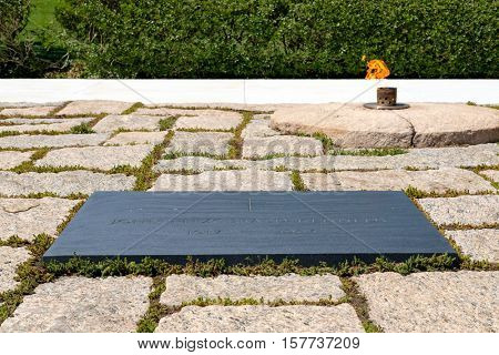 The Eternal Flame and the President John F. Kennedy tombstone at Arlington National Cemetery near Washington D.C.