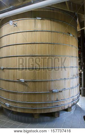 Oak barrel vat for fermentation in bourbon distillery.
