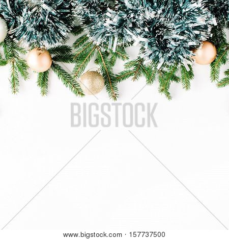 Christmas composition with fir branches pine cones christmas balls and tinsel. Flat lay top view