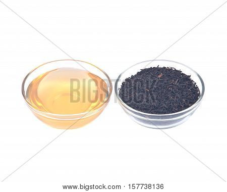 Organic amish farm pure honey and camellia sinensis assam tea in bowl isolated on white background