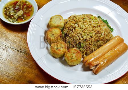 fried rice in black soy sauce and sausage with chili fish sauce cup