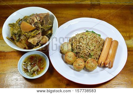 fried rice in black soy sauce and Chinese vegetable stew