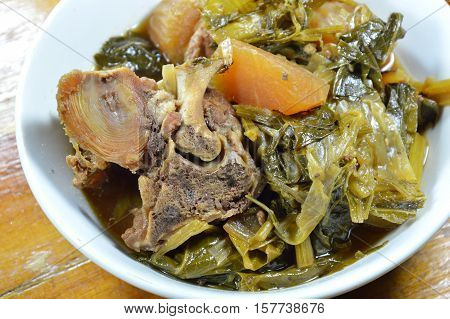 Chinese mixed vegetable and pork bone stew on bowl