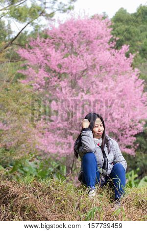 Beautiful Thai woman with Wild Himalayan Cherry portrait
