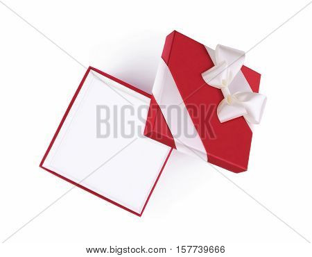 Top view of open red gift box with white satin ribbon and bow isolated on white background