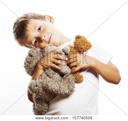 little cute boy with many teddy bears hugging isolated on white background close up