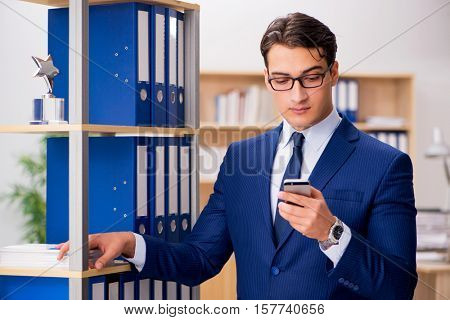 Handsome businessman speaking on mobile phone