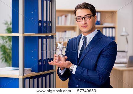 Handsome businessman with star award