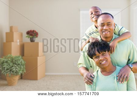 Happy African American Family In Room with Packed Moving Boxes.
