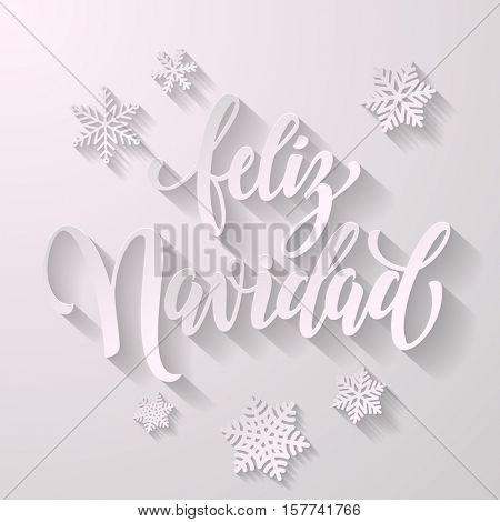 Spanish Merry Christmas Feliz Navidad text for greeting with snowflakes and frosty white lettering with shadow on white background. Vector paper cut design