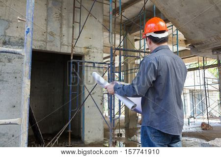 Engineer Architect  At Construction Site With Blueprint