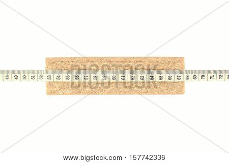 Bread crisp and measuring tape isolated on white background. A symbol of diet