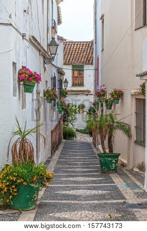 Narrow street in the andalusian town Estepona Costa del Sol Spain