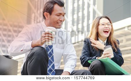 Man and woman talking and drinking from cups
