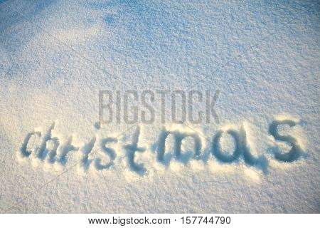 the background from text Christmas on snow