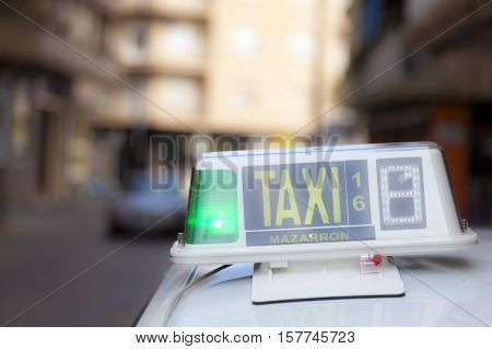 Taxi sign in the city of Mazarron. Region Murcia Costa Calida Spain poster