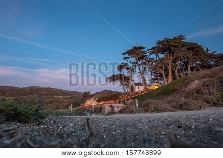 Building on the hill with trees at twilight