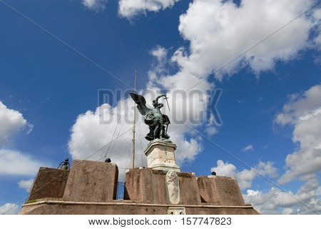 Bronze angel cast in 1753 at the top of Castel Sant'Angelo in Rome with beautiful clouds