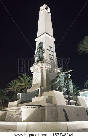 CARTAGENA SPAIN - OCT 22 2016: Monument column in the city of Cartagena illuminated at night. Region of Murcia Spain