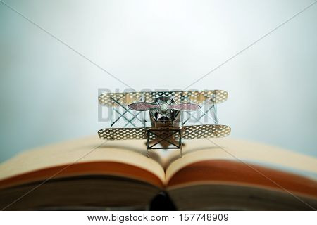 Aircraft Figther On Open Book With Abstract Light Studious Student, Education, Concept.
