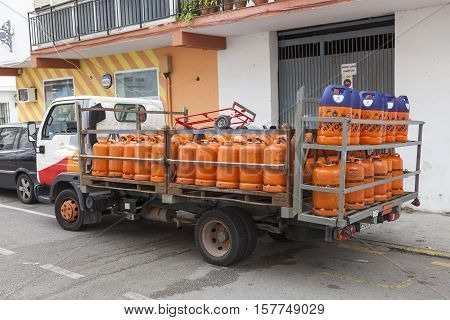 ESTEPONA SPAIN - OCT 20 2016: Propane gas bottles delivery truck in the city of Estepona. Costa del Sol Spain