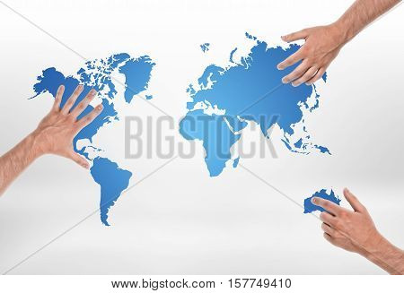 Three male hands put on different parts of world map. Geography and natural resources. Global issues. International trade and relations.
