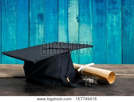 Graduation Cap, Hat With Degree Paper On Wood Table, Vintage Wood Background Empty Ready For Your Pr