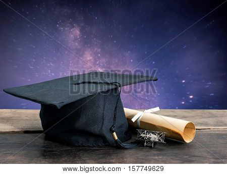 Graduation Cap, Hat With Degree Paper On Wood Table, Milky Way Background Empty Ready For Your Produ