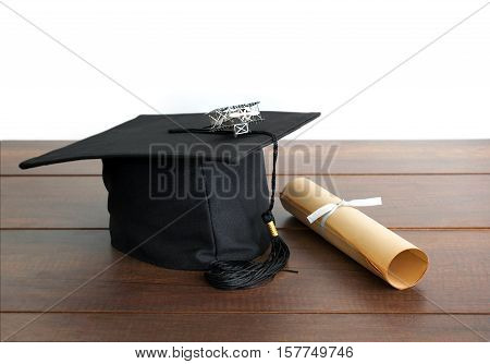 Graduation Cap, Hat With Degree Paper And Plane Toy On Wood Table Empty Ready For Your Product Displ