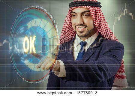 Arab man pressing ok button