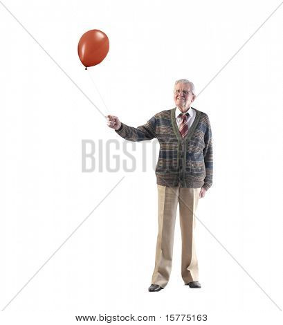 Senior man holding a balloon