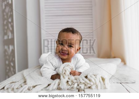 African American Baby Boy Lying Baby Boy Lying On Tummy At Home