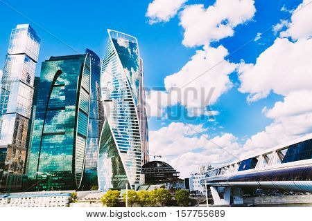 The complex of skyscrapers Moscow and Bagration Bridge on the background of beautiful blue sky with cumulus clouds fluffy