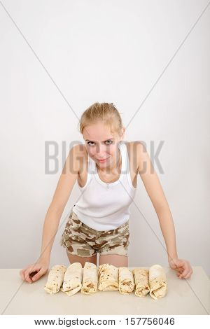 happy girl and prepared homemade doner kebab or shwarma on white background with copyspace